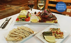 Yiamas Greek Taverna: Traditional Kontosouvli Spit Roast Feast + Wine for Two ($39) or Four ($77) at Yia Mas Greek Taverna (Up to $166 Value)