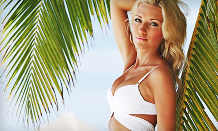 Tropical Tan - Quail Hollow: One Month of Unlimited Level 1 UV Tanning or Three Mystic Tan Spray Tans at Tropical Tan (Up to 82% Off)