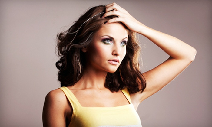 Salon Flux - Downtown: $15 for Three Feather Hair Extensions at Salon Flux ($30 Value)