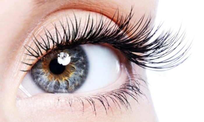 La Petite Spa - Central West End: $99 for Eyelash Extensions (Up to $300 Value) or $45 for a Body Wrap ($90 Value) at La Petite Spa