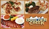 Boulder Creek - Multiple Locations: $15 for $30 Worth of Steakhouse Fare and Drinks at Boulder Creek Steakhouse