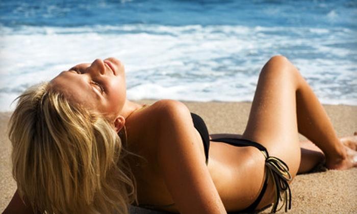 Magictan Studios - Moores Switch: VersaSpa Spray Tan or Semester of Bed Tanning at Magictan Studios (Up to 57% Off)