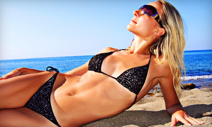 Hair Illusions & Tanning - Roscoe: One Month of Bed Tanning or Two or Four Spray Tans at Hair Illusions & Tanning (Up to 65% Off)