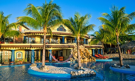 3-, 5-, or 7-Night Stay for Two at Caribe Tesoro in Roatán, Honduras. Combine Multiple Nights.