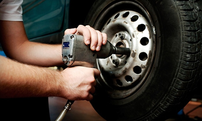 Auto Care Super Saver  - 1 Stop Tire and Automotive: $33 for Three Oil Changes, One Tire Rotation, and Additional Services in Randallstown from Auto Care Super Saver (Up to $179.95 Value)
