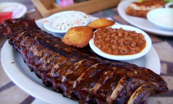 Slow & Low Bar-B-Que - Cocoa Beach: $7 for $15 Worth of Barbecue Fare and Drinks at Slow & Low Bar-B-Que in Cocoa Beach
