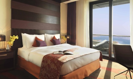 Abu Dhabi 1 3 Night Ramadan Stay for 2 Adults and 2 Children with Breakfast, Theme Park Tickets at 4* Radisson Blu Hotel