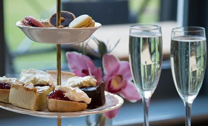 image for Afternoon Tea with Prosecco for Two or Four at Worplesdon Place (Up to 51% Off)