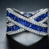 White Gold Plated Blue Spinel and Cubic Zirconia Crisscross Ring