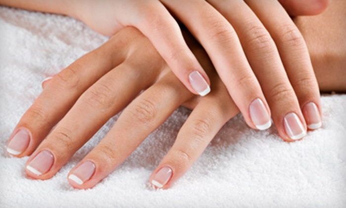 Bella Spa & Tanning - Waterloo: Shellac Manicure Package, Mani-Pedi Package, or Spa Beauty Package at Bella Spa & Tanning (Up to 65% Off)