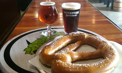 Pints and Pub Pretzel or Pints and Growler at Pitchfork Brewing Company (Up to 40% Off)