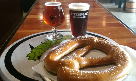 Pints and Pub Pretzel or Pints and Growler at Pitchfork Brewing Company (Up to 43% Off)