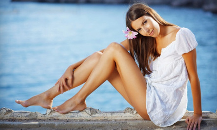 Sandy Beaches Tanning Salon - Multiple Locations: Two Mystic Tans or Tanning Package with One Month Tanning and Premium Tan at Sandy Beaches Tanning Salon (Up to 72% Off)
