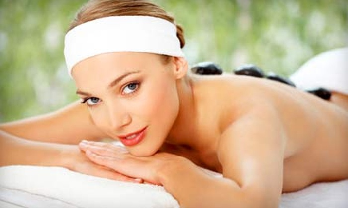 Dream Weaver Massage, Spa, and Tanning - Downtown: Hot-Stone Massage Package or 30-, 60-, or 90-Minute Massage at Dream Weavers Massage, Spa, and Tanning
