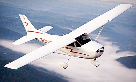 $69 for One Discovery Flight Lesson with Souvenir Video from Freedom Aviation ($155 Value)