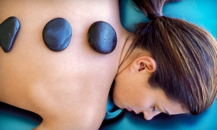 Nails R Us - West Omaha: $40 for a 60-Minute Hot-Stone Massage at Nails R Us ($80 Value)