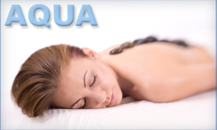 Aqua Aesthetic Studio - Castle Knoll Farms: $45 for a One-Hour Hot-Stone Massage ($100 Value) or $45 for a Microdermabrasion Face Treatment ($120 Value) at Aqua Aesthetic Studio