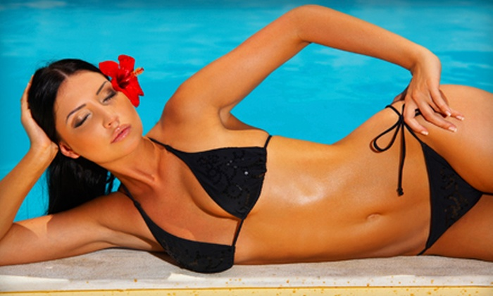The Tan Inn - Saint Charles: 3 Standup Tans or 10 Bed Tans at The Tan Inn in St. Peters (Up to 67% Off)