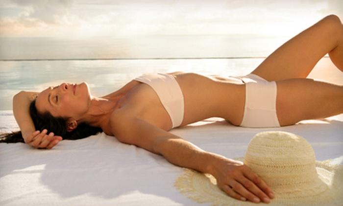 Sunsets Tanning - Multiple Locations: One Airbrush Tan or Three Tanning-Bed Sessions at Sunsets Tanning