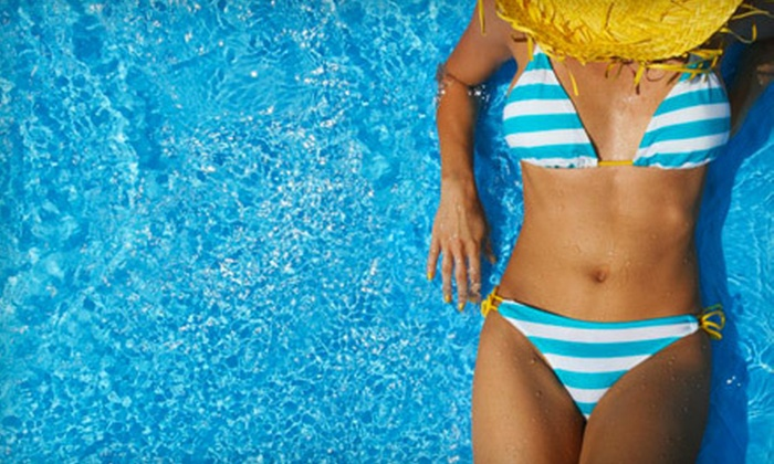 Solar 51 - Multiple Locations: $35 for One Month of Unlimited UV Tanning or Five Mystic Tan Spray Tans at Solar 51 (Up to $70 Value)