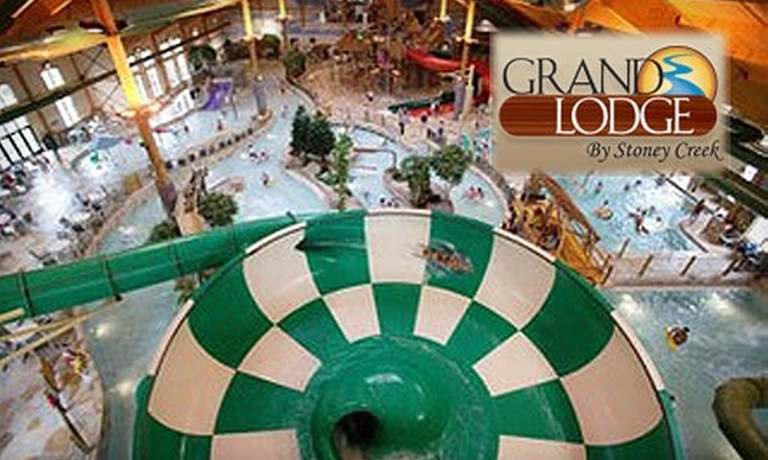 Grand Lodge by Stoney Creek - Rothschild: $59 for a One-Night Stay in Expanded King or Queen Sofa-Sleeper Room Plus Four Water Park Passes at the Grand Lodge by Stoney Creek (Up to $149 Value)