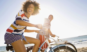 Pier Surf: All-Day Beach Cruiser Bike Rental or Three-Hour Surfboard Rental at Pier Surf (Up to 40% Off)