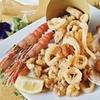 Menu di pesce o carne con vino a Ostia