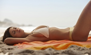 Sun Club Tanning: Two Weeks of Unlimited VIP-Service Package or a Mystic-Tan Spray Tan at Sun Club Tanning (Up to 78% Off)