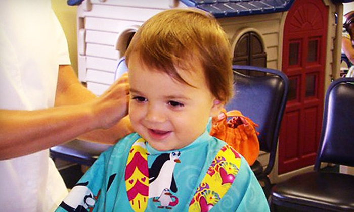 Bananas Salon for Kids - Fort Myers: Two Kids' Haircuts or Kids' Haircut Package with Mani-Pedi or Hair Tinsel at Bananas Salon for Kids (Up to 55% Off)