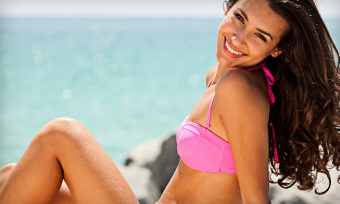 Salon Tropics - Shenandoah: One Month of Unlimited UV Tanning or Two Mystic Tan Spray Tans at Salon Tropics (Up to 63% Off)