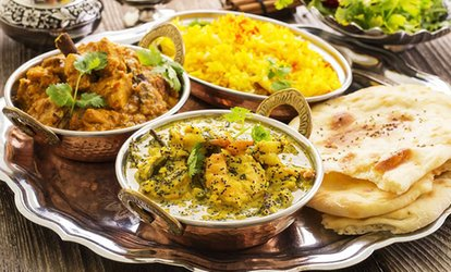$8.95 for Two Curries with Rice, $9.95 to Add Naan, or $10.95 to Add a Third Curry at Masala Grill, CBD