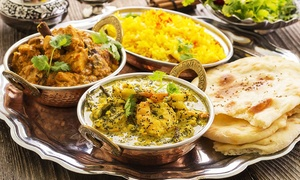 Masala Grill: $8.95 for Two Curries with Rice, $9.95 to Add Naan, or $10.95 to Add a Third Curry at Masala Grill, CBD