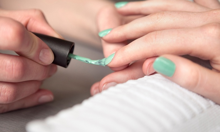 Madison Salon & Spa - Woodbury: Shellac Manicure or Shellac Mani-Pedi or Spa Mani-Pedi at Madison Salon & Spa (Up to 53% Off)