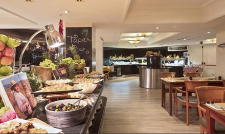AllYouCanEat Spanish Buffet with Sangria for Up to Four at The Place Restaurant