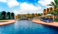 Pool and Beach Access with Meal and House Beverage or Overnight Stay at Golden Tulip Al Jazira (Up to 80% Off)