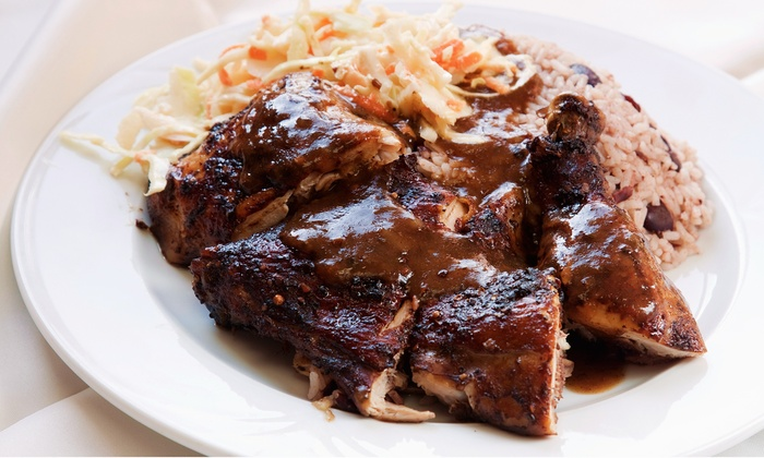 Reggae Wings & Tings - Garland: Jamaican Food for Two or Four at Reggae Wings & Tings (Half Off)