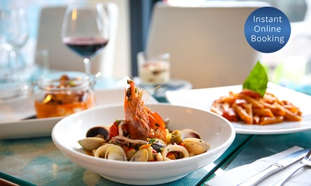 Three-Course Italian Dining and Wine for Two ($79) or Four People ($155) at Isola D'Ischia Ristorante (Up to $322 Value)