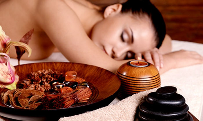 The Retreat Salon and Day Spa - Avery Road Retail Center: Upper-Body Hot-Stone Massage with Gel Manicure or Pedicure at The Retreat Salon and Day Spa (Up to 53% Off)