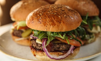 image for Any Two Gourmet Burgers and Any Two Sides at BóBó's (Up to 56% Off)