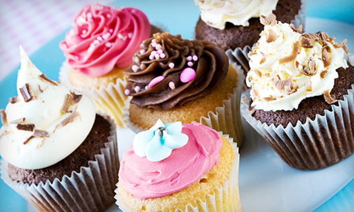 A Cupcakes World - Charlotte: One or Two Dozen Cupcakes, or $25 for $50 Worth of Custom Cakes from A Cupcakes World