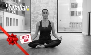 Yoga Bar: $14 for 2 Weeks of Unlimited Yoga, Barre and Pilates Classes at Choice of Seven Locations with YogaBar (Up to $35 Value)