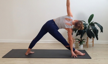 One Month of Unlimited Yoga Classes for One $29 or Two People $55 at Love Yoga Up to $360 Value