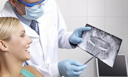 $93 for ComprehensiveExam,Full Mouthof Xrays,Teeth Cleaning&Flouride Application at The Bonner Dental Network $565 Value