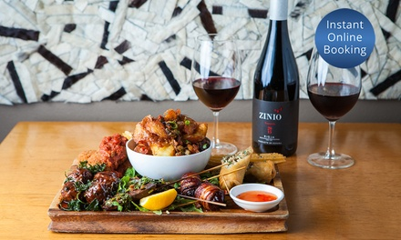 Tapas Platter + Bottle of Spanish Wine: Two $59, Four $115 or Eight People $225 at Toro Bravo Up to $360 Value