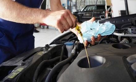 One Green Oil Change or $50 for $100 Worth of Automotive Services at Green Earth Automotive