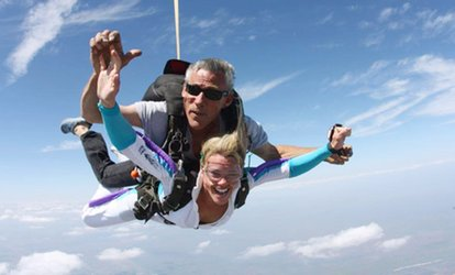 image for Tandem Skydive Photo Shoot Package for One, Two, or Four at Skydive Spaceland (Up to 46% Off)