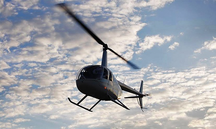 MaxFlight Helicopter Services Inc. - MaxFlight Helicopter Services Inc.: $119 for Helicopter Tour for Up to 3 with 1 Souvenir T-Shirt from MaxFlight Helicopter Services Inc. ($375 Value)