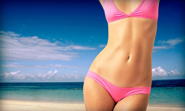 Luminous Sun Studio - City Centre: One Spray Tan or One Month of Unlimited UV Tanning at Luminous Sun Studio (Up to 73% Off)