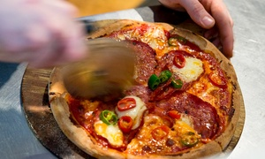 Beehive Hotel: $29 for a Wood-Fired Pizza with a Bottle of Wine and a Choice of Side for Two People at Beehive Hotel (Up to $65 Value)