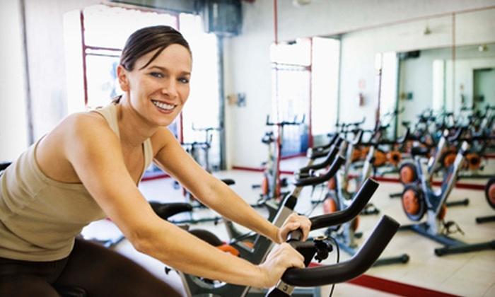 SpinCity Training Studio - Boston: 10 Spin Classes or One 60-Minute Massage at SpinCity Training Studio (Up to 68% Off)
